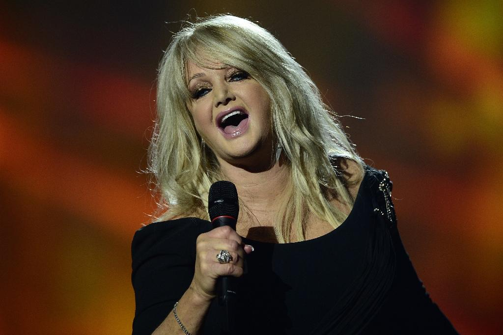 "Britain's Bonnie Tyler, shown here at the 2013 Eurovision song contest, will mark next week's solar eclipse with a performance of her very own ""Total Eclipse of the Heart"" -- on a cruise ship (AFP Photo/JOHN MACDOUGALL)"
