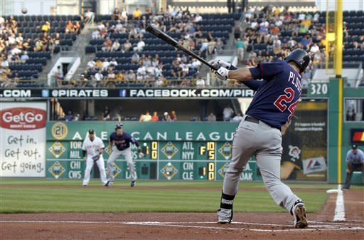 Minnesota Twins' Trevor Plouffe (24) hits a single to drive in Josh Willingham in the first inning of a baseball game against the Pittsburgh Pirates on Wednesday, June 20, 2012, in Pittsburgh. (AP Photo/Keith Srakocic)