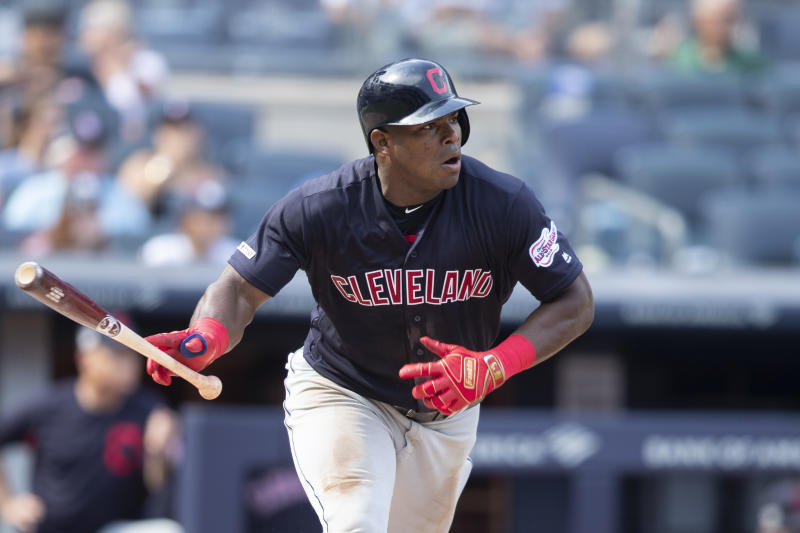 Cleveland Indians' Yasiel Puig watches the ball after hitting a double during the eighth inning of a baseball game, Saturday, Aug. 17, 2019, in New York. (AP Photo/Mary Altaffer)