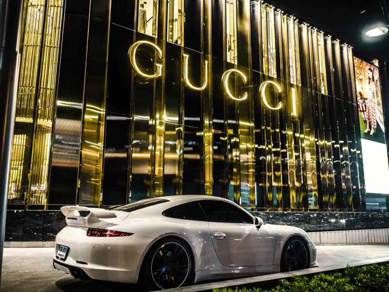 Bangkok, Thailand - February 21, 2016: Porsche car parked in front of the Gucci shop at the luxury mall Central Embassy in Bangkok Thailand