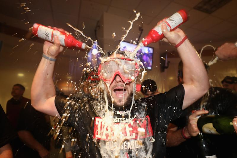 Chris Owings celebrates after the D-backs win. They clinched a wild-card berth Sunday. (Getty Images)