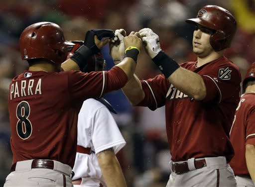 Arizona Diamondbacks' Paul Goldschmidt, right, is congratulated by teammate Gerardo Parra after hitting a grand slam during the seventh inning of a baseball game against the St. Louis Cardinals, Wednesday, June 5, 2013, in St. Louis. (AP Photo/Jeff Roberson)
