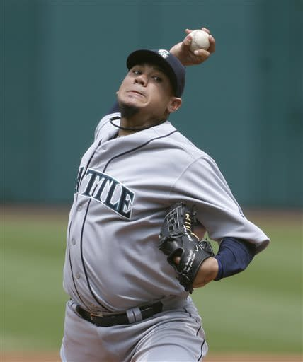 Seattle Mariners starting pitcher Felix Hernandez delivers in the first inning of a baseball game against the Cleveland Indians, Sunday, May 19, 2013, in Cleveland. (AP Photo/Tony Dejak)