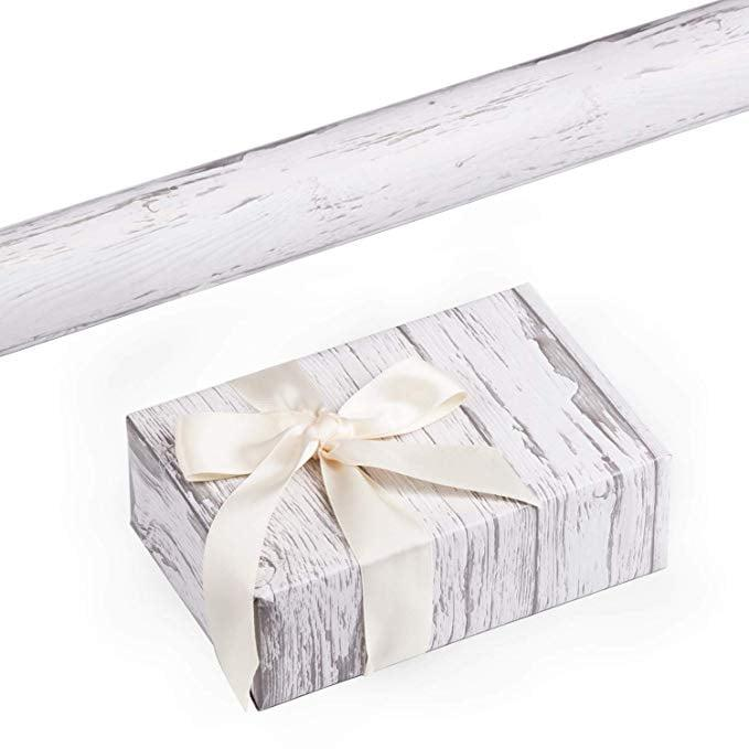 """<p>Wrap all your presents in this chic <a href=""""https://www.popsugar.com/buy/Ruspepa-Gift-Wrapping-Paper-Roll-518640?p_name=Ruspepa%20Gift%20Wrapping%20Paper%20Roll&retailer=amazon.com&pid=518640&price=20&evar1=casa%3Aus&evar9=46907457&evar98=https%3A%2F%2Fwww.popsugar.com%2Fhome%2Fphoto-gallery%2F46907457%2Fimage%2F46907459%2FRuspepa-Gift-Wrapping-Paper-Roll&list1=shopping%2Camazon%2Choliday%2Choliday%20decor&prop13=api&pdata=1"""" rel=""""nofollow"""" data-shoppable-link=""""1"""" target=""""_blank"""" class=""""ga-track"""" data-ga-category=""""Related"""" data-ga-label=""""https://www.amazon.com/dp/B07JB8H3FW/ref=s9_acsd_bw_wf_a_x_cdl_8?pf_rd_m=ATVPDKIKX0DER&amp;pf_rd_s=merchandised-search-top-3&amp;pf_rd_r=NH3YFK0D8M7XS3VDRC62&amp;pf_rd_t=101&amp;pf_rd_p=18be90a5-1b3b-42b9-af4d-9c3e209e5752&amp;pf_rd_i=20435302011"""" data-ga-action=""""In-Line Links"""">Ruspepa Gift Wrapping Paper Roll</a> ($20).</p>"""