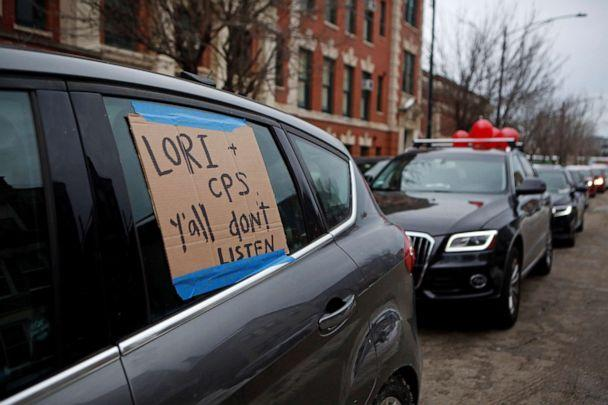PHOTO: Supporters of the Chicago Teachers Union participate in a car caravan as negotiations with Chicago Public Schools continue over a COVID-19 safety plan agreement in Chicago, Jan. 30, 2021. (Eileen Meslar/Reuters)