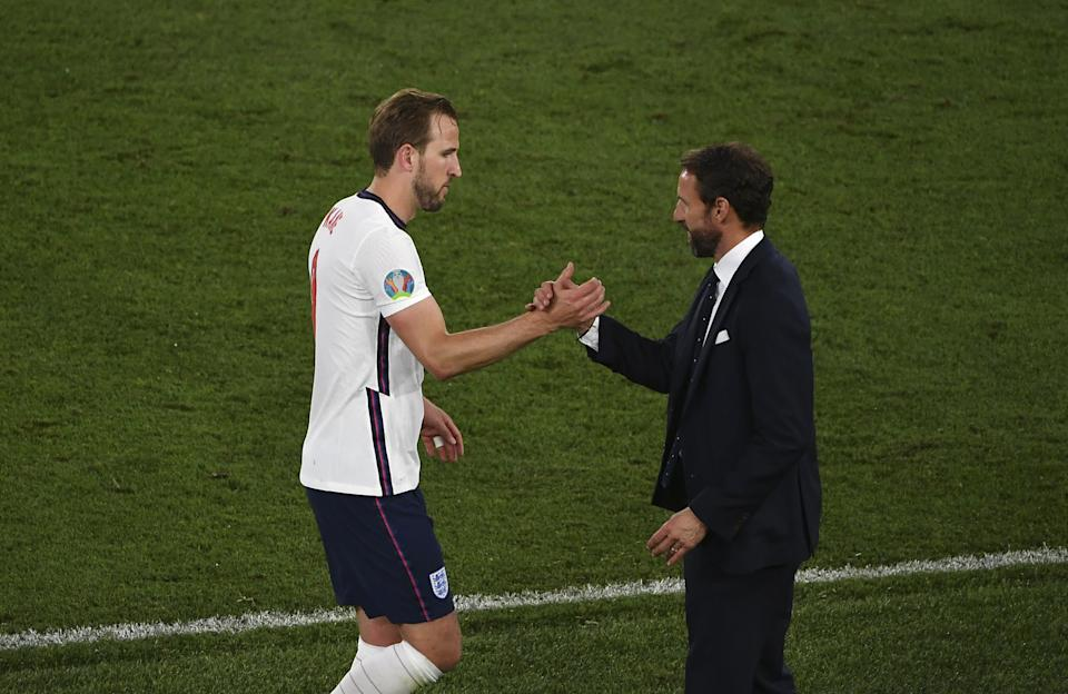 Harry Kane (pictured left) congratulated by head coach Gareth Southgate (pictured right) as he leaves the pitch during the UEFA EURO 2020 quarterfinal football match between Ukraine and England.