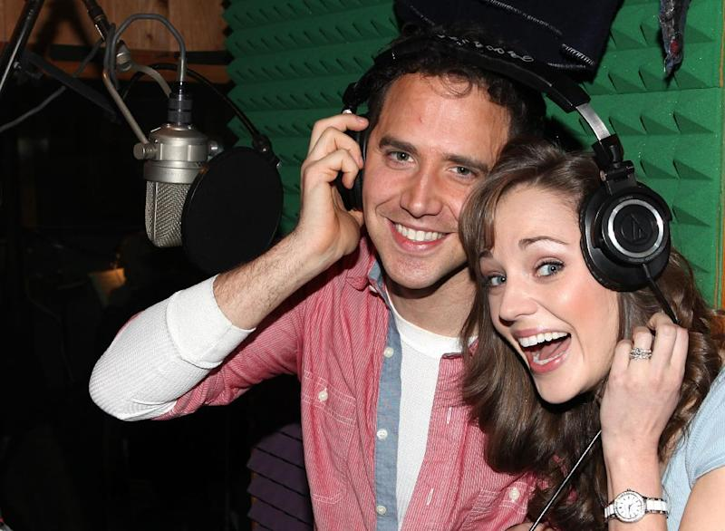 """This March 18, 2013 photo released by Fortune Creative shows Santino Fontana, left, and Laura Osnes  recording the Original Broadway Cast Recording of Broadway's """"Rodgers & Hammerstein's Cinderella"""" at MSR Studios in New York. The 29-member cast, plus a 20-piece orchestra that was split up over half a dozen rooms and booths, recorded their cast album in one day. (AP Photo/Fortune Creative, Walter McBride)"""
