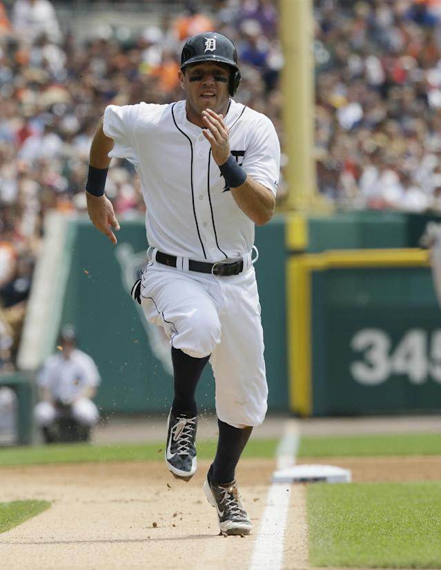 Detroit Tigers' Ian Kinsler runs home on teammate Victor Martinez's sacrifice during the first inning of a baseball game against the Cleveland Indians, Sunday, July 20, 2014 in Detroit. (AP Photo/Carlos Osorio)