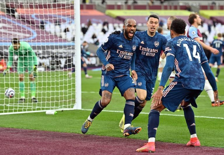Three and easy: Alexandre Lacazette (2nd left) scored the equaliser as Arsenal came from 3-0 down to draw 3-3 at West Ham