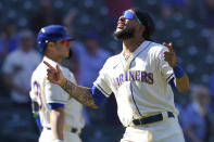 Seattle Mariners' J.P. Crawford reacts after he scored on a two-run triple hit by Mitch Haniger during the fifth inning of a baseball game against the Houston Astros, Sunday, April 18, 2021, in Seattle. (AP Photo/Ted S. Warren)