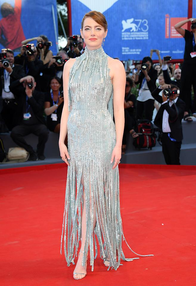<p>Stone dazzles in a fringed Versace gown at the world premiere of 'La La Land' in Venice on Aug. 31. She plays a young struggling actress working as a barista in the romantic musical. (Photo: Venturelli/WireImage) </p>