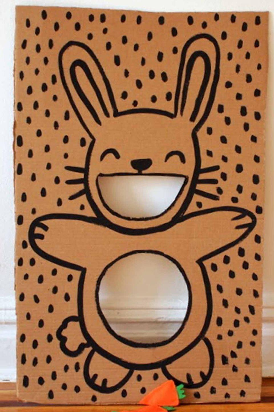 """<p>This is a festive and fun twist on the classic game. Kids will have a blast tossing carrot bean bags through this grinning bunny. </p><p><em>Get the tutorial at <a href=""""http://www.pinkstripeysocks.com/2014/04/diy-easter-bunny-bean-bag-toss.html"""" rel=""""nofollow noopener"""" target=""""_blank"""" data-ylk=""""slk:Pink Stripey Socks"""" class=""""link rapid-noclick-resp"""">Pink Stripey Socks</a>.</em></p>"""