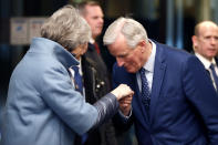 FILE - In this Monday, March 11, 2019 file photo, British Prime Minister Theresa May, left, is welcomed by European Union's chief Brexit negotiator Michel Barnier in Strasbourg, France. He's known throughout most of Europe as Mr. Brexit, but not so well known at home in France. With a new book out this week, and interviews in national media, Michel Barnier is trying to raise his profile ahead of next April's presidential election. (Vincent Kessler/Pool Photo via AP, File)