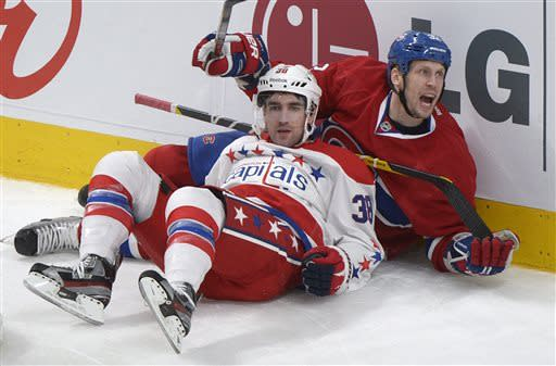 Montreal Canadiens' Travis Moen, right, collides with Washington Capitals' Jack Hillen during second period NHL hockey action in Montreal, Saturday, April 20, 2013. (AP Photo/The Canadian Press, Graham Hughes)