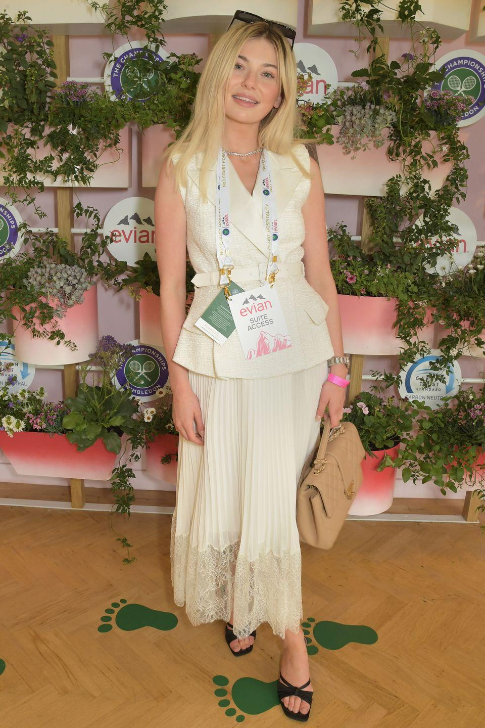 <p>Georgia Toffolo posed in the Evian suite wearing a traditional all-white Self-Portrait look for Wimbledon. </p>