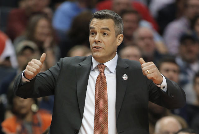 Virginia coach Tony Bennett signals for a jump ball during the first half of the team's first-round game against UMBC. (AP)