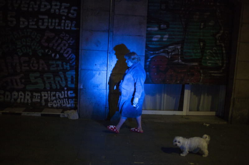 A lady walking her dog , through the streets of the Raval neighborhood, Barcelona, Spain, on March 18, 2020. (José Colon for Yahoo News)