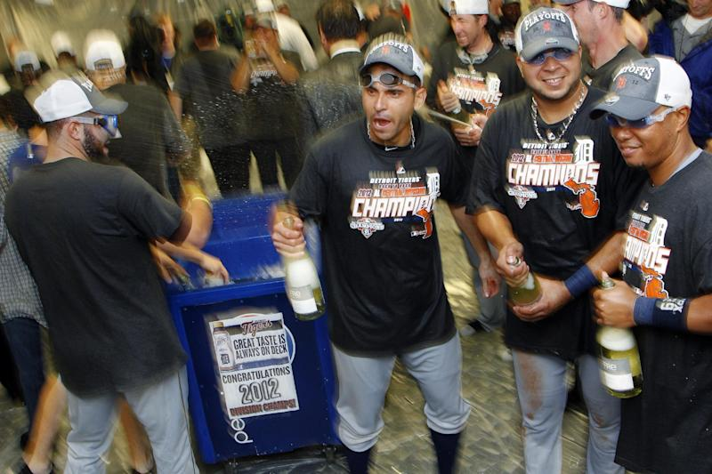 Members of the Detroit Tigers celebrate following a baseball game against the Kansas City Royals at Kauffman Stadium in Kansas City, Mo., Monday, Oct. 1, 2012. The Tigers defeated the Royals 6-3 and clinched the AL Central title. (AP Photo/Orlin Wagner)
