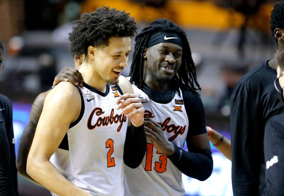 Oklahoma State's Cade Cunningham (2) and Isaac Likekele (13) celebrate during the second half of a 81-77 win against Arkansas on Jan. 30.