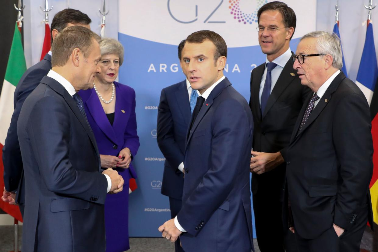Theresa May speaking with EU leaders at the G20 (Getty)