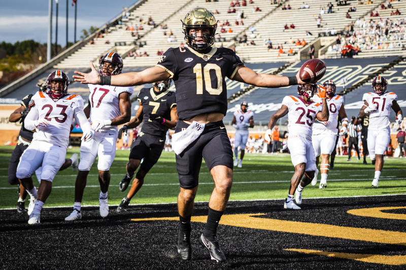 Wake Forest sophomore quarterback Sam Hartman (10) celebrates after scoring a touchdown during an NCAA college football game against Virginia Tech on Saturday, Oct. 24, 2020 at Truist Field in Winston-Salem, N.C. (Andrew Dye/The Winston-Salem Journal via AP)