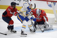 Washington Capitals goaltender Vitek Vanecek (41) stops the puck against Buffalo Sabres left wing Taylor Hall, center, during the first period of an NHL hockey game, Friday, Jan. 22, 2021, in Washington. Capitals left wing Conor Sheary (73) looks on. (AP Photo/Nick Wass)