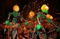 <p>Festive jack-o'-lanterns are carried on poles by handlers in the 44th annual Village Halloween Parade in New York City on Oct. 31, 2017. (Photo: Gordon Donovan/Yahoo News) </p>