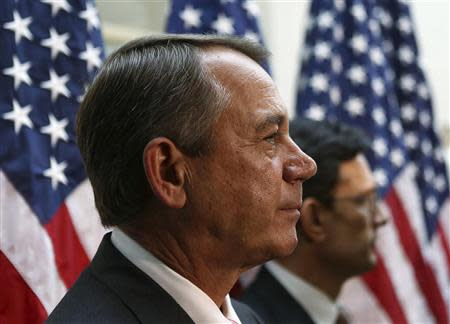 U.S. Speaker of the House John Boehner (R-OH) (L) and Rep Eric Cantor (R-VA) (R) attend a news conference with Republican House members in Washington October 10, 2013. REUTERS/Gary Cameron