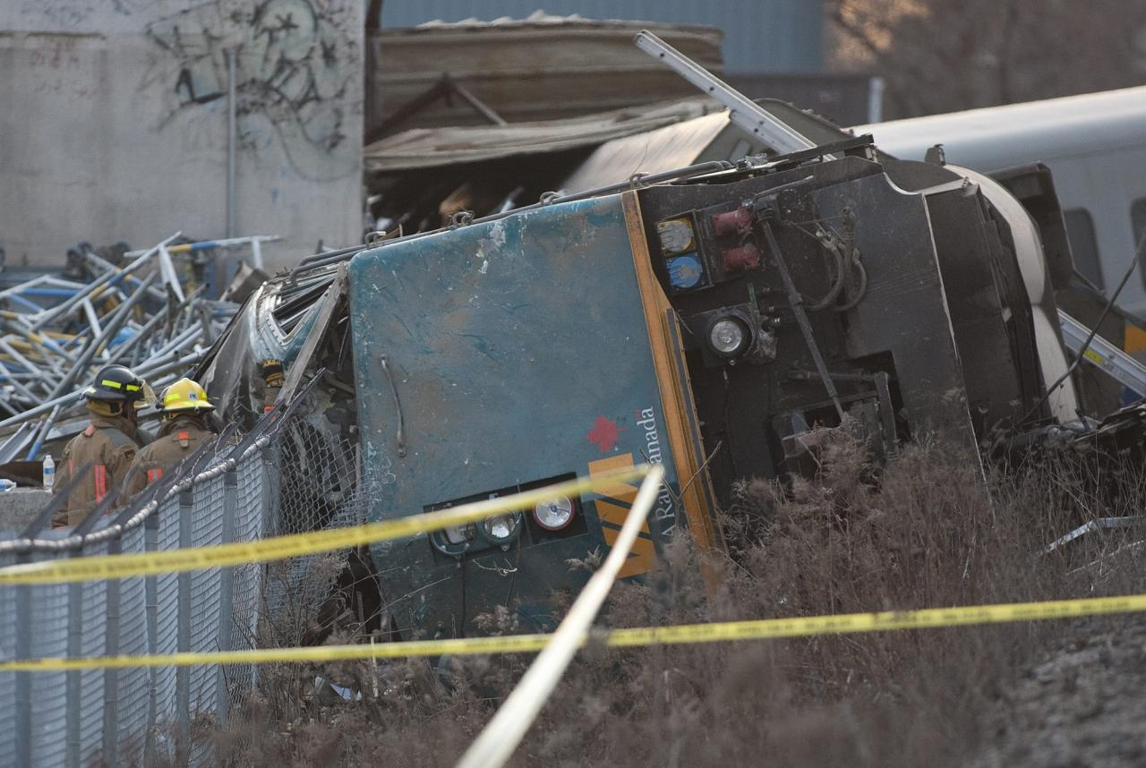 Rescue crews work on a derailed Via Rail passenger train in Burlington, Ontario on Sunday, Feb. 26, 2012. Burlington Mayor Rick Goldring says three people are dead after the Toronto-bound train derailed in his town. (AP Photo/The Canadian Press, Pawel Dwulit)