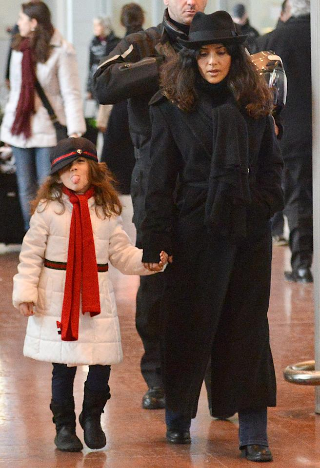 January 18, 2013: Salma Hayek and daughter, Valentina Paloma Pinault, are seen arriving at the Charles de Gaulle International Airport in Paris, France today.