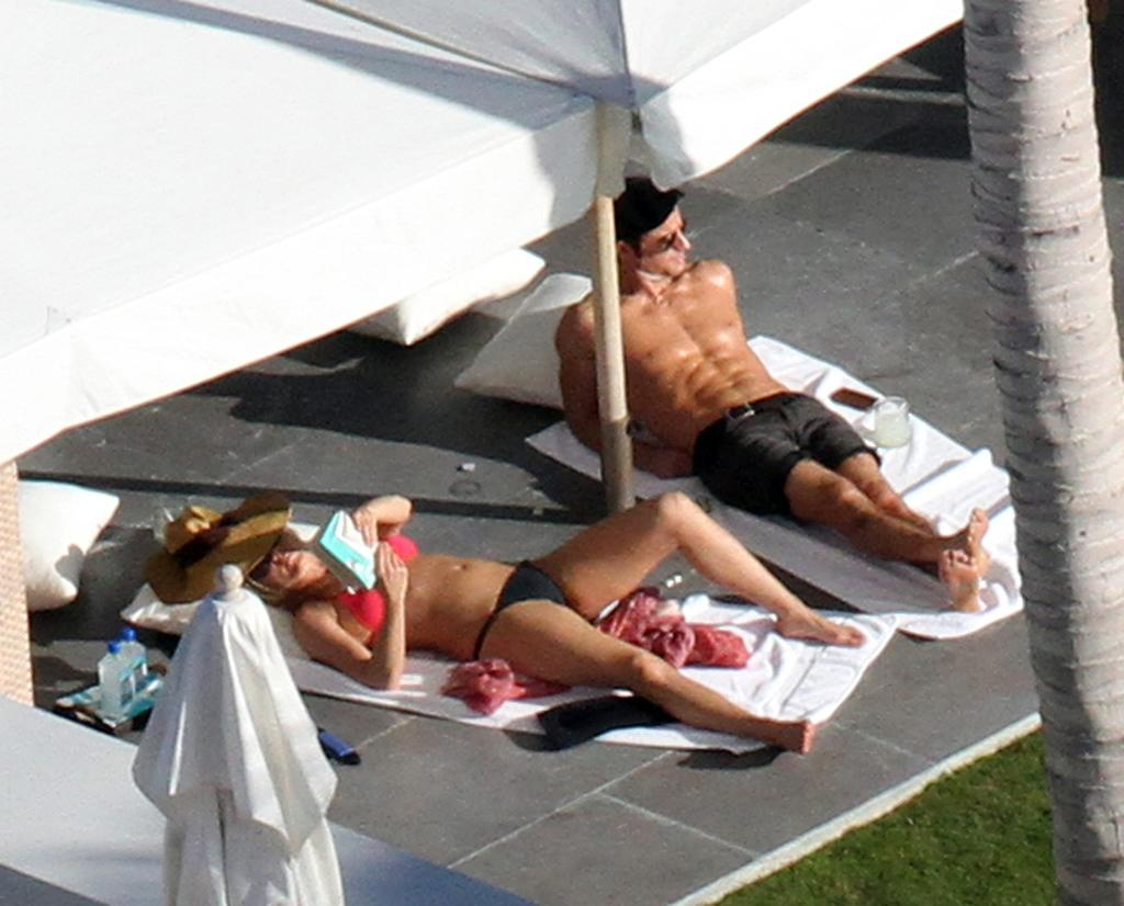 Jennifer Aniston and Justin Theroux sunbathing on their Mexico vacation.