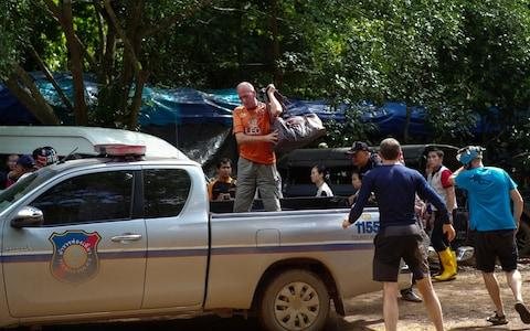 British caver Vernon Unsworth gets out of a pick up truck near the Tham Luang cave complex - Credit: REUTERS/Panu Wongcha-um