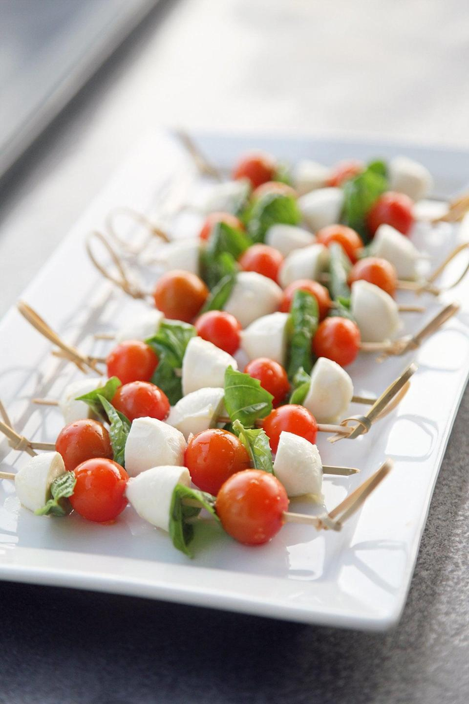 """<p>How could you say no to easy-to-prepare finger fare? These caprese skewers are made with tomato, mozzarella, and basil, and their simplicity is genius. They're superlight, so if you're looking to feed two people, it's best to make about five to six skewers so you can both indulge. </p> <p><strong>Get the recipe:</strong> <a href=""""https://www.popsugar.com/food/Caprese-Skewers-Recipe-140427"""" class=""""link rapid-noclick-resp"""" rel=""""nofollow noopener"""" target=""""_blank"""" data-ylk=""""slk:caprese skewers"""">caprese skewers</a></p>"""