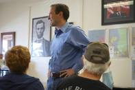 In this Sunday, Oct. 10, 2021, photo Republican Adam Laxalt speaks at the Douglas County Republican Party Headquarters on the final day of his Senate campaign's statewide tour in Gardnerville, Nev. Republican Laxalt hopes to win the race for Nevada's U.S. Senate seat by drawing stark between his positions and the direction he says Democrats and their allies in Big Tech, Hollywood and the media are taking the country. (AP Photo/Sam Metz)