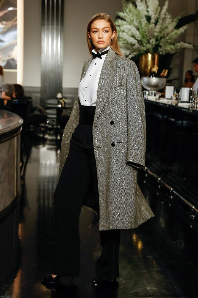 Gigi Hadid in bowtie and overcoat.