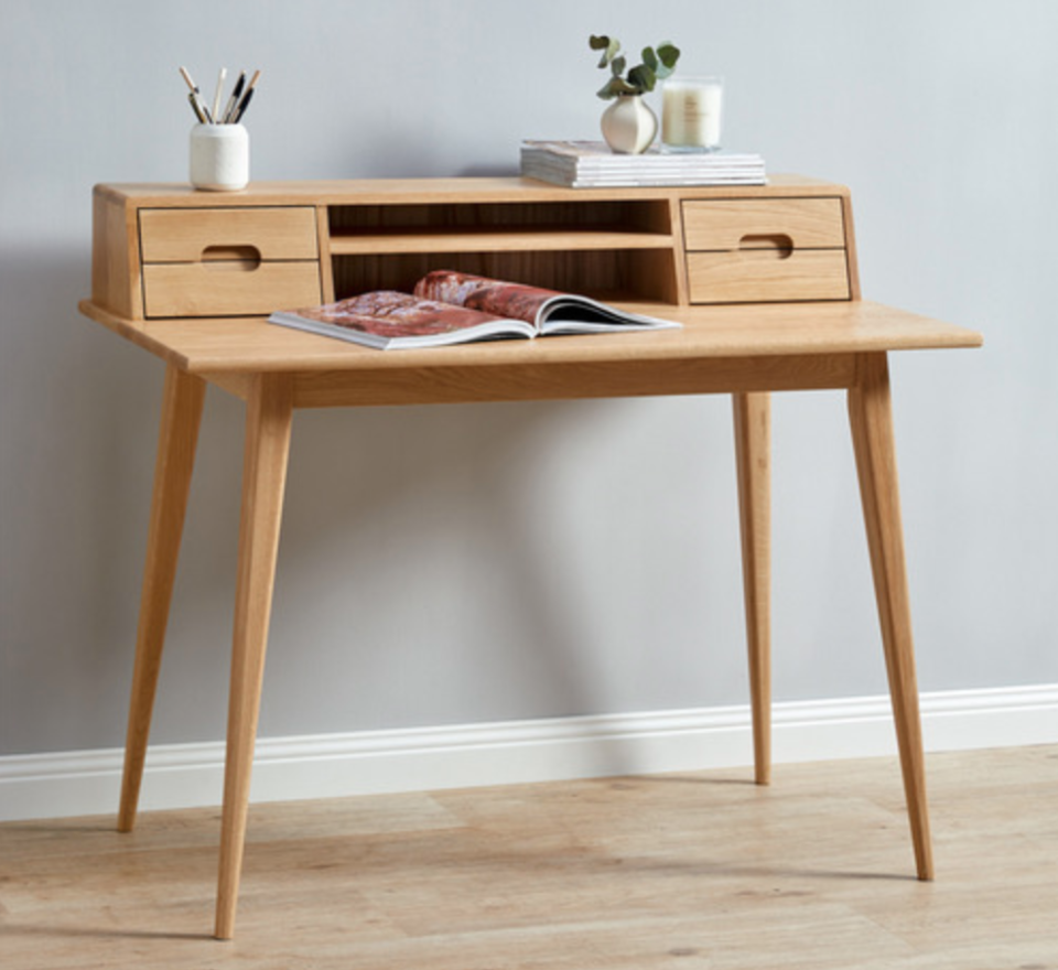Scandi-style desk from Temple & Webster with storage built into the monitor stand