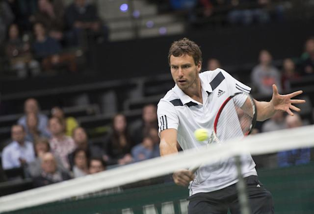 Latvia's Ernests Gulbis returns the ball to Czech Tomas Berdych, during their semi-finals match, of the 41st ABN AMRO world tennis tournament, at Ahoy Arena, in Rotterdam, Netherlands, Saturday Feb. 15, 2014. (AP Photo/Patrick Post)