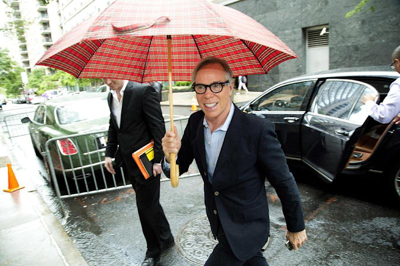 """This June 4, 2012 photo shows fashion designer Tommy Hilfiger arriving for rehearsals for the CFDA Awards in New York. Hilfiger has been in the fashion business for more than 40 years, starting at a little denim shop in Elmira, N.Y., and now at the helm of a brand that's one of the most recognizable in the world. This spring, he added """"American Idol"""" style adviser to his resume. His peers at the Council of Fashion Designers of America honored him Monday night with a lifetime achievement award. (AP Photo/Charles Sykes)"""