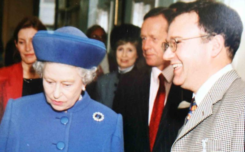 Dr Peter Fisher, pictured with the Queen, was a member of the royal medical household - REX/Shutterstock
