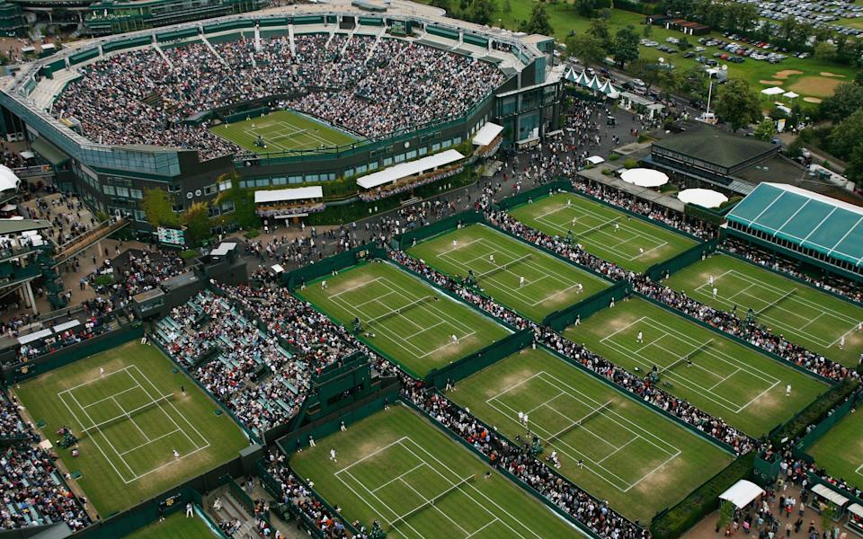 An aerial view a roofless Centre Court and the outside courts taken from the BBC elevated camera position during day four of the Wimbledon Lawn Tennis Championships at the All England Lawn Tennis and Croquet Club - - GETTY IMAGES