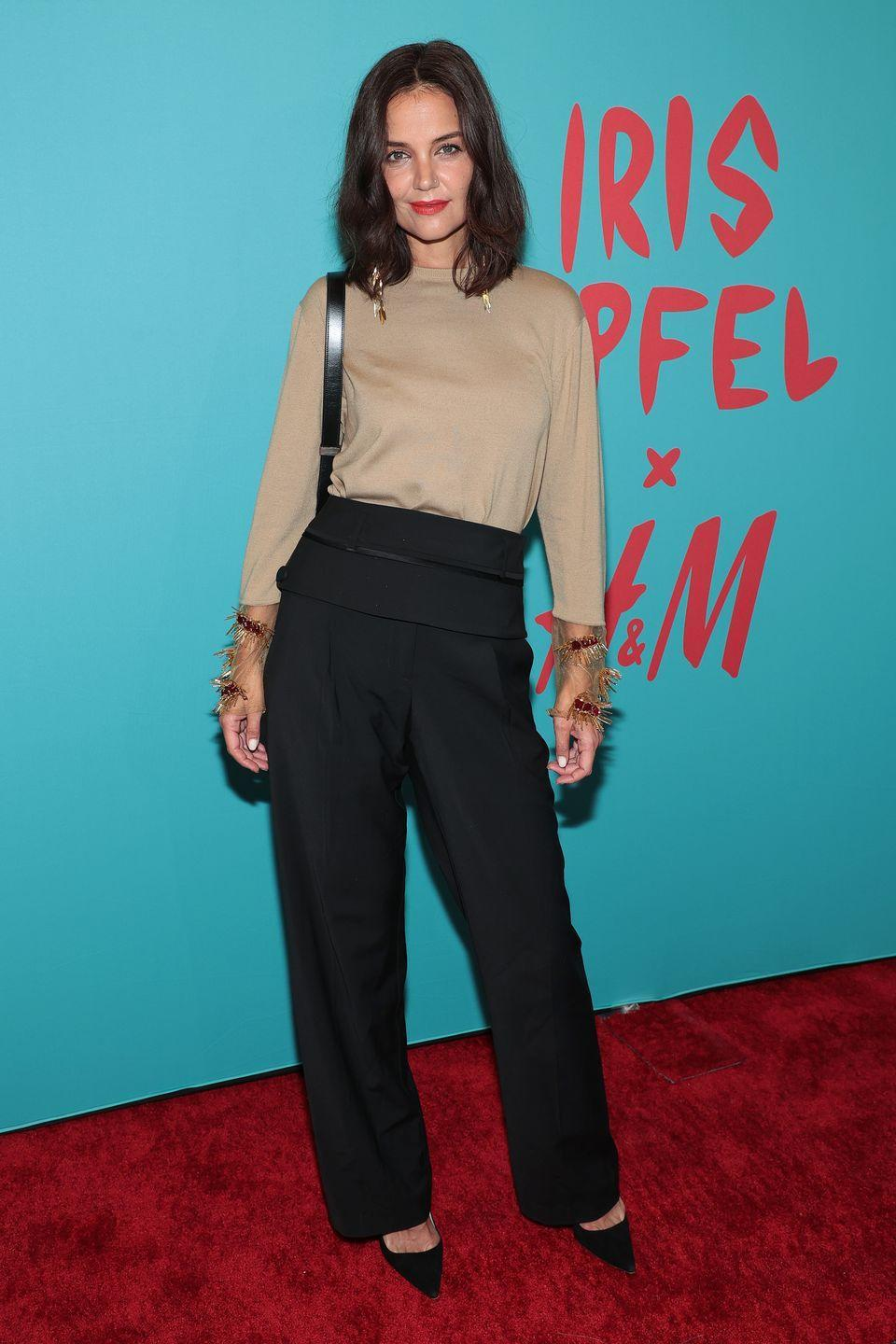 <p><strong>9 September</strong></p><p>Katie Holmes arrived to celebrate the happy event. She wore a pair of black tailored trousers and a nude sleeved top. </p>