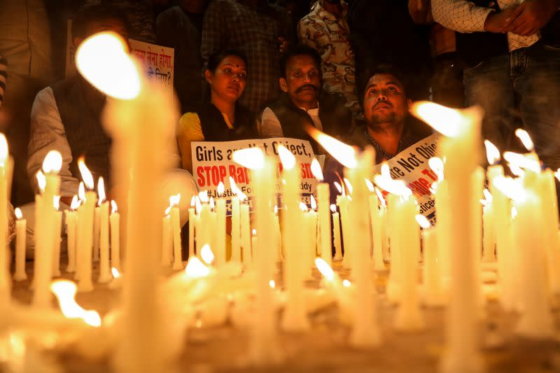 People attend a candle light march to protest against the alleged rape and murder of a 27-year-old woman on the outskirts of Hyderabad, in New Delhi