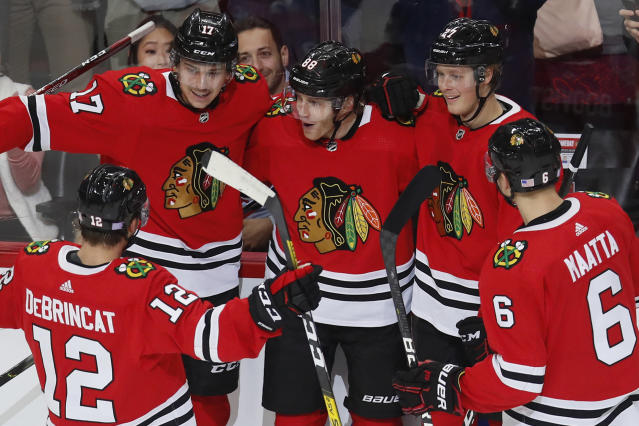 Chicago Blackhawks' Patrick Kane, center, celebrates his goal against the Toronto Maple Leafs with teammates Alex DeBrincat, Dylan Strome, Adam Boqvist and Olli Maatta, from left, during the first period of an NHL hockey game Sunday, Nov. 10, 2019, in Chicago. (AP Photo/Jim Young)