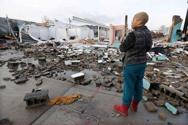 PHOTO: Faith Patton looks over buildings destroyed by storms, March 3, 2020, in Nashville, Tenn. (Mark Humphrey/AP)