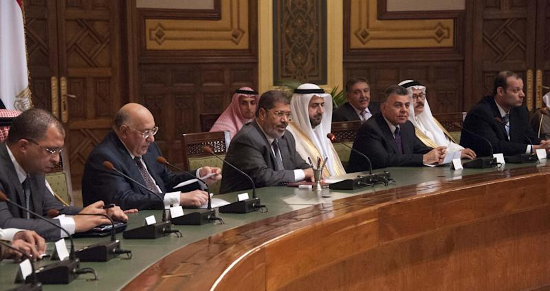 This image released by the Egyptian Presidency shows President Mohammed Morsi, center, meeting with Saudi businessmen in Cairo, Egypt, Tuesday, Sept. 11, 2012. (AP Photo/Egyptian Presidency)