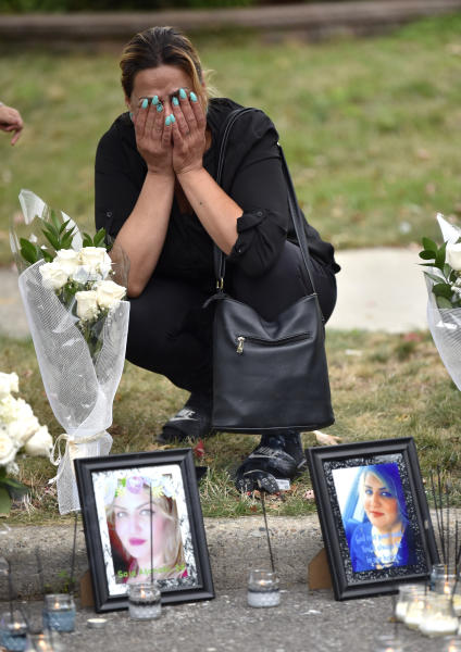 Close-family friend Zena Abbo cries at the makeshift memorial of her friend, Saja Aljanabi Sunday, Sept. 8, 2019, as they light candles around her memorial  in Dearborn, Mich.  Dearborn Police Chief Ronald Haddad said Thursday, Sept. 12, 2019, that the 14-year-old, a 13-year-old and 17-year-old are being held in connection with last week's killing of Saja Aljanabi and they could be involved in other crimes in the area. (Todd McInturf/Detroit News via AP)