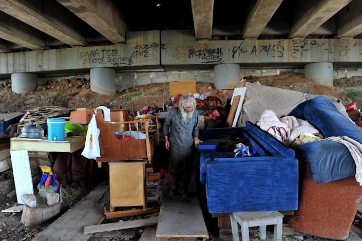 A homeless Greek pensioner who has been living under a highway in Thessaloniki since 2011 (AFP Photo/Sakis Mitrolidis)
