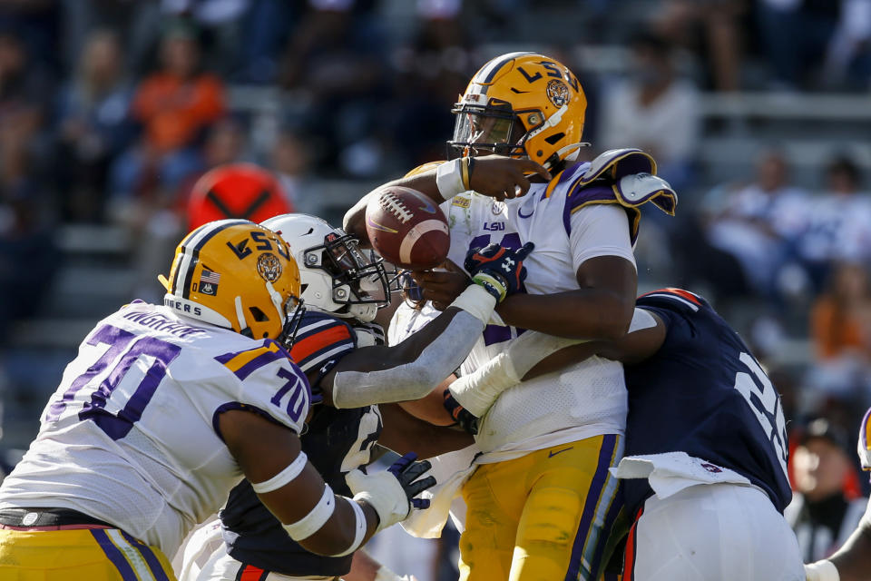 Auburn linebacker Derick Hall (29) strips the ball from LSU quarterback TJ Finley (11) while tackling him during the second quarter of an NCAA college football game on Saturday, Oct. 31, 2020, in Auburn, Ala. (AP Photo/Butch Dill)