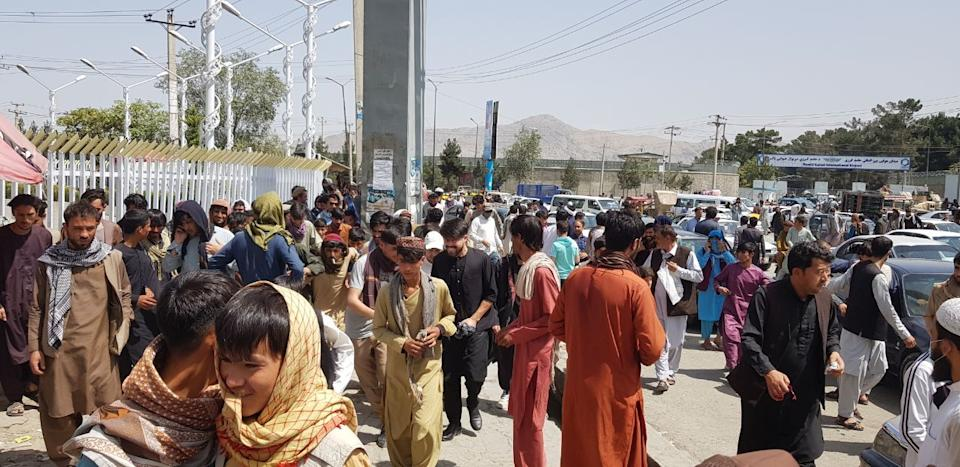 KABUL, AFGHANISTAN-AUGUST 17: Thousands of Afghans rush to the Kabul International Airport as they try to flee the Afghan capital of Kabul, Afghanistan, on August 17, 2021. (Photo by Sayed Khodaiberdi Sadat/Anadolu Agency via Getty Images)