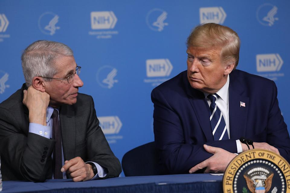 Anthony Fauci, director of the National Institute of Allergy and Infectious Diseases, and President Donald Trump during a briefing on the coronavirus. (Photo: Leah Millis / Reuters)